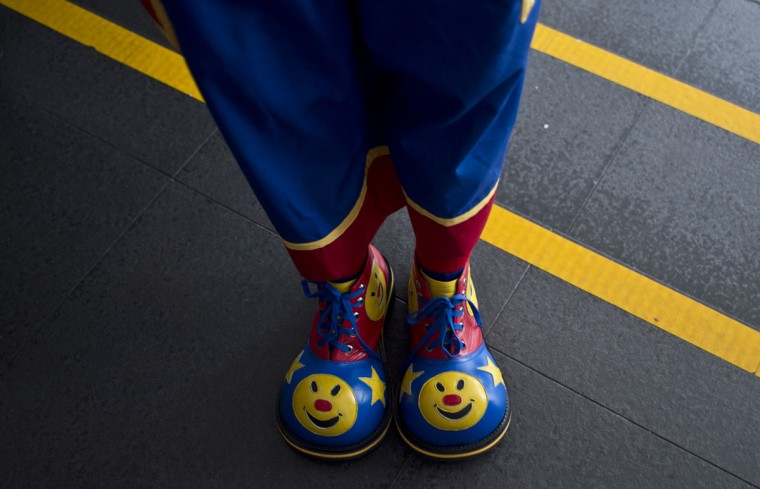 A clown's shoes are seen prior to a parade during a Clown Festival in Kuala Lumpur on August 17, 2014. Around 80 clowns from all over Malaysia took part in the event organized by the Association of Clowns Malaysia to provide a platform for clown education, acquiring new skills and offering members support. (Manan Vatsyayana/AFP/Getty Images)