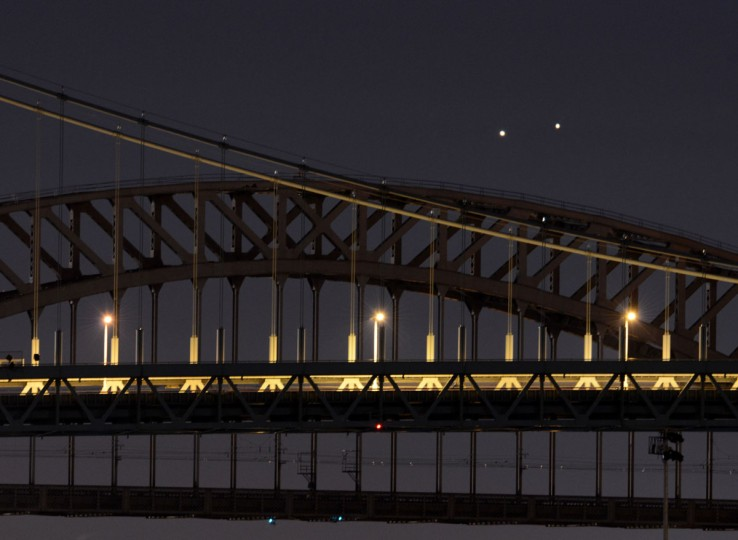 Venus (left) and Jupiter rise together in a rare conjunction over the Hell Gate (rear) and Robert F. Kennedy (front) Bridges in the early morning of August 18, 2014 in New York. The two planets were separated by about 0.25 degrees as viewed from Earth. They will appear farther apart each day but still relatively close together about 45 minutes before sunrise this week. (STAN HONDA/AFP/Getty Images)