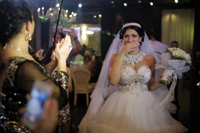 "Israeli bride Morel Malcha is pictured ahead of her wedding ceremony to Arab Israeli Muslim groom, Mahmoud Mansour (unseen), in Mahmoud's family home in the Jaffa district of Tel Aviv on August 17, 2014. The union of Mahmoud and Morel was marred by the shouts of hundreds of young Israeli protesters responding to the call of the extreme right-wing Organization for Prevention of Assimilation in the Holy Land (LEHAVA), which militates against the ""Jewish assimilation and intermarriage."" (Daniel Bar-On/AFP/Getty Images)"