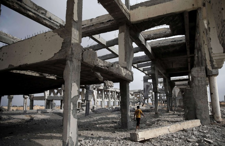 A Palestinian boy makes his way through the rubble of the destroyed and deserted terminal of the Gaza strips former international airport in the southern city of Rafah on August 18, 2014. Egyptian-brokered indirect negotiations between Israel and the Palestinians are taking place during a five-day lull in the fighting that is due to expire at midnight (2100 GMT). (THOMAS COEX/AFP/Getty Images)