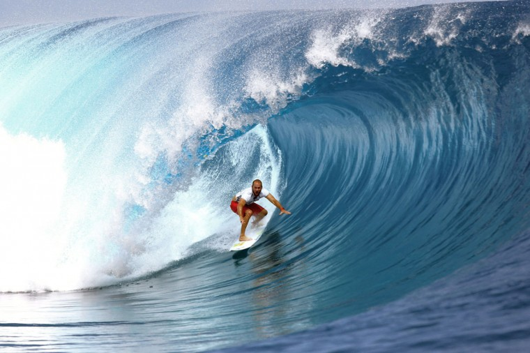 USA's C. J. Hobgood rides a wave on August 18, 2014 during the 14th edition of the Billabong Pro Tahiti surf event, part of the ASP (Association of Surfing Professionals) world tour, in Teahupoo, on the French Polynesian island Tahiti. (AFP PHOTO/Getty Images/Gregory Boissy)