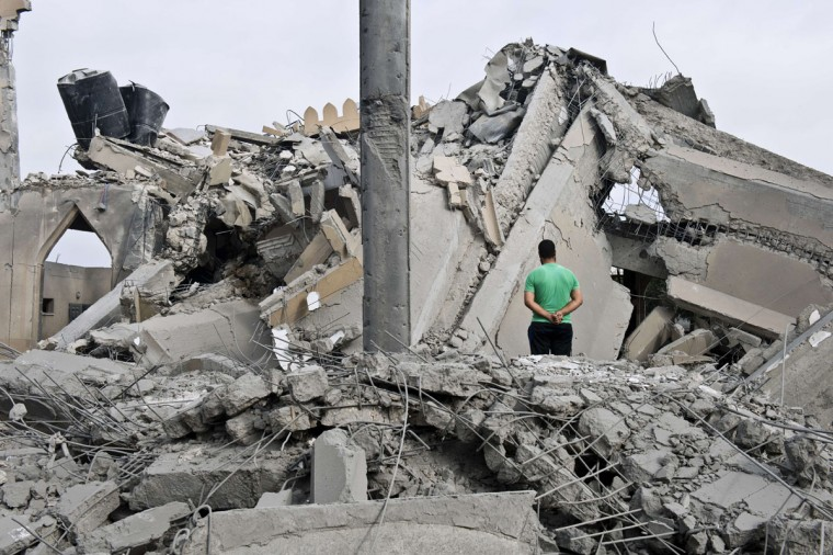 A Palestinian man stands amid the rubble of a mosque that was partially damaged by an Israeli airstrike on August 25, 2014 in Beit Lahia in the northern Gaza Strip. (ROBERTO SCHMIDT/AFP/Getty Images)