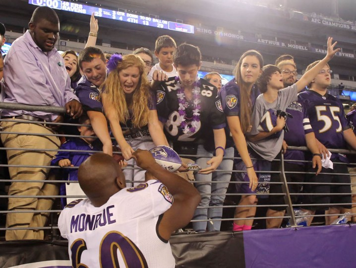 Ravens' Eugene Monroe signs autographs after the Baltimore Ravens defeated on the San Francisco 49ers at M&T Bank Stadium in Baltimore, MD on Thursday, August 7, 2014. (Al Drago/Baltimore Sun)