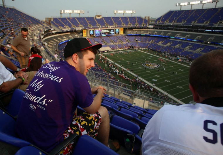 Jordan Monk is all smiles before the start of the Ravens preseason opener against the San Francisco 49ers at M&T Bank Stadium in Baltimore, MD on Thursday, August 7, 2014. Monk traveled two and a half hours with Scott Ward, and Mike Ward from Crisfield, Md. to watch the game in their seats. They have been season ticket holders since 1996. (Al Drago/Baltimore Sun)