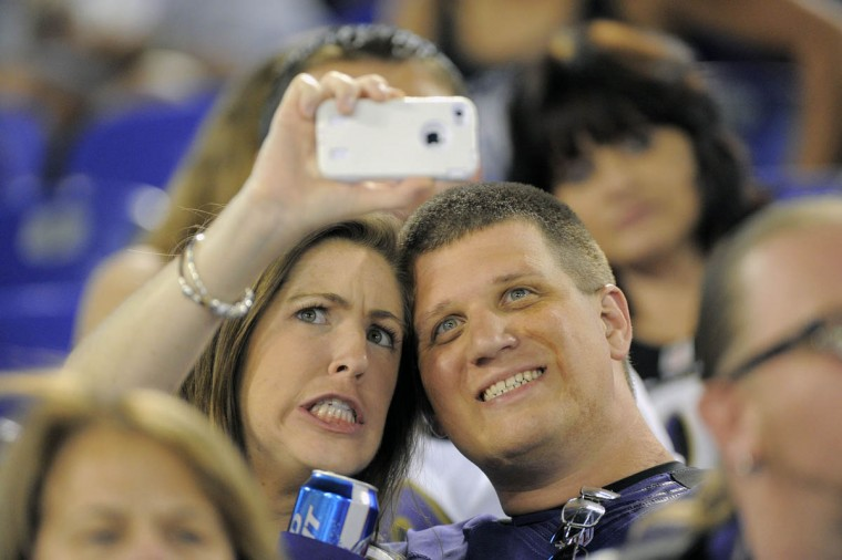 Fans take a selfie during the game as a play is questioned on the field as the Baltimore Ravens take on the San Francisco 49ers at M&T Bank Stadium in Baltimore, MD on Thursday, August 7, 2014. (Al Drago/Baltimore Sun)