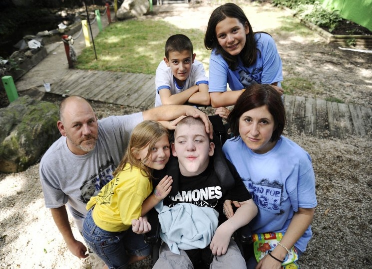 From top left, John Smith, 12, Grace Smith, 12, From bottom left, Michael Smith Jr., Martie Smith, 7, Mickey Smith, 12, and Cathy Smith, all of Gambrills. John, Grace and Mickey are triplets and siblings to Martie. Mickey has a progressive neuromuscular disease. (Rachel Woolf/Baltimore Sun)