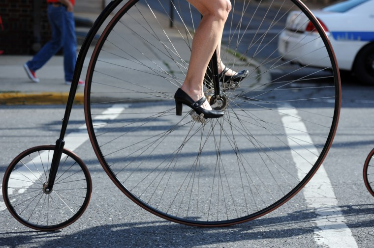 Angela Long of West Friendship chose high heels for pedaling her high wheels. Long is competing in the 2014 Frederick Clustered Spires High Wheel Race for the third time. (Kim Hairston/Baltimore Sun)