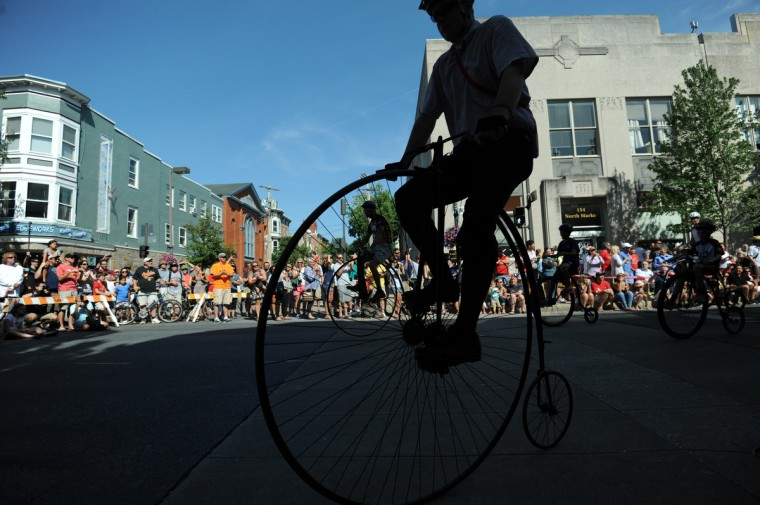 """Riders take a warm up lap before the competition begins. The 2014 Frederick Clustered Spires High Wheel Race, billed as the """"only high wheel race of its kind in America,"""" is held in historic downtown Frederick. (Kim Hairston/Baltimore Sun)"""
