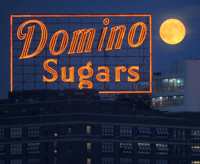A perigree full moon or supermoon rises Sunday night over the Domino Sugars plant in Baltimore. (Jerry Jackson/Baltimore Sun)