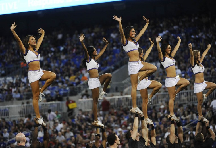 Ravens cheerleaders stand up and cheer in the game against the San Francisco 49ers at M&T Bank Stadium on August 7, 2014. The Ravens won 23-3. (Rachel Woolf/Baltimore Sun)