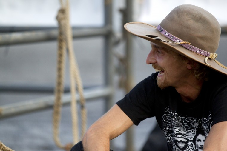 Bull rider Robert Carter of Bradford, Fla., has a laugh before the start of the Bull Blast. during the 69th Annual Howard County Fair in West Friendship on Monday, August 4, 2014. (Jen Rynda/BSMG)