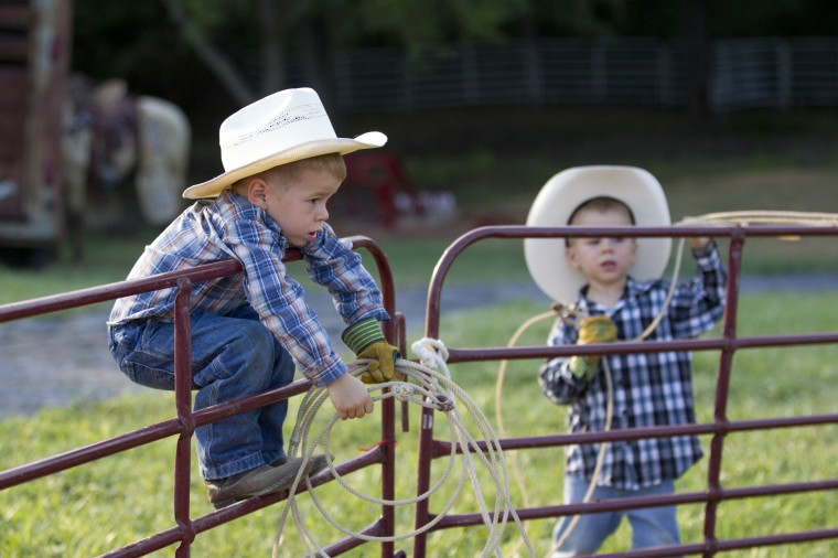 Matthew Crum, left, 4, of Thurmont, and his twin brother Andrew Crum, right, 4, hang out before the Bull Blast at the 69th Annual Howard County Fair in West Friendship, on Monday, August 4, 2014. (Jen Rynda/BSMG)