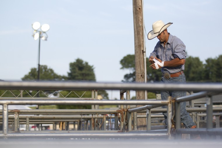 Bull rider Gene Stoltzfus of Chestertown gets ready for the start of the Bull Blast during the 69th Annual Howard County Fair in West Friendship, on Monday, August 4, 2014. (Jen Rynda/BSMG)