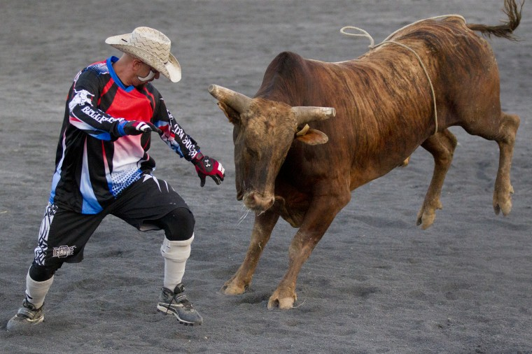 A rodeo clown engages a bull during Bull Blast at the 69th Annual Howard County Fair in West Friendship on Monday, August 4, 2014. (Jen Rynda/BSMG)