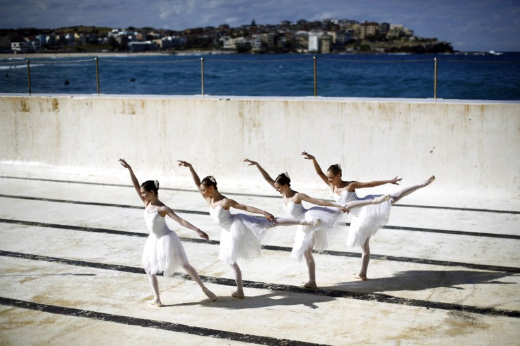 Dancers from the Australian Ballet are pictured inside the Bondi Icebergs oceanside pool in Sydney, August 7, 2014. The dancers, taking advantage of the pool being emptied for cleaning, were on hand to promote their February 2015 production of Swan Lake at Sydney's Capitol Theatre. (Jason Reed/Reuters)