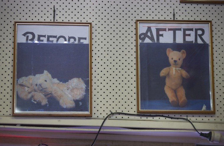 Two photographs hanging on the wall of Sydney's Doll Hospital show the before and after pictures of a teddy bear that had been brought in for repair. (Jason Reed/Reuters)