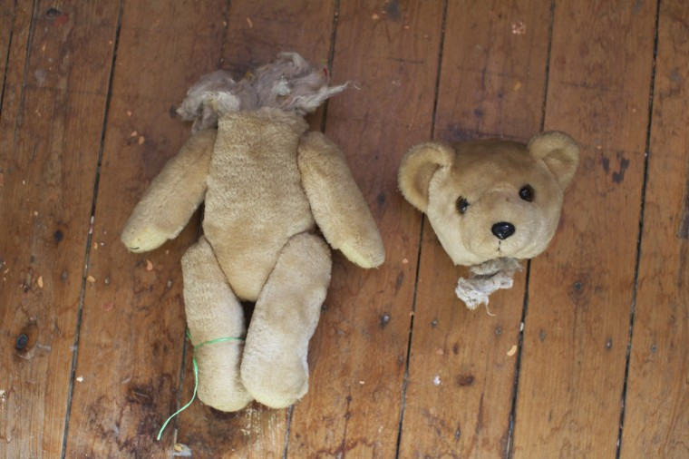A teddy bear in two pieces is pictured on the workshop floor at Sydney's Doll Hospital. (Jason Reed/Reuters)
