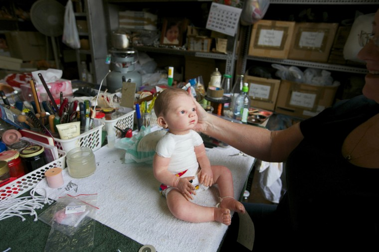 A damaged doll is pictured on a workbench after having its head re-attached by 25-year veteran doll repairer Kerry Stuart at Sydney's Doll Hospita. (Jason Reed/Reuters)