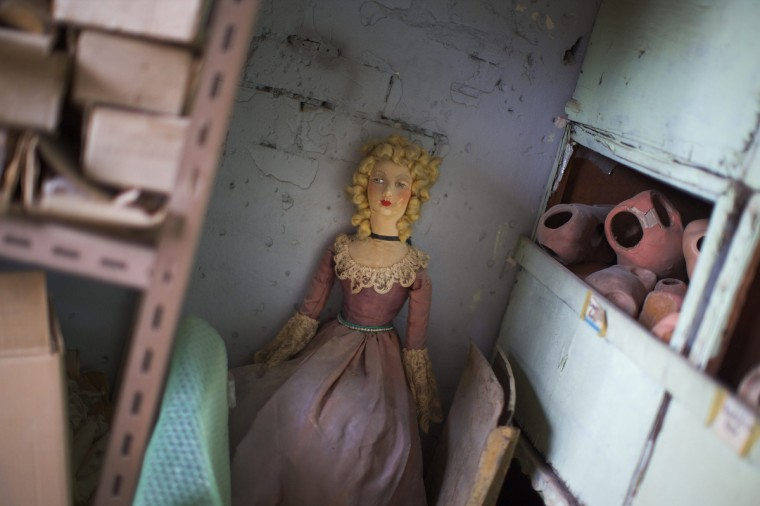 A discarded doll is pictured against a wall in the workshop of Sydney's Doll Hospital. (Jason Reed/Reuters)