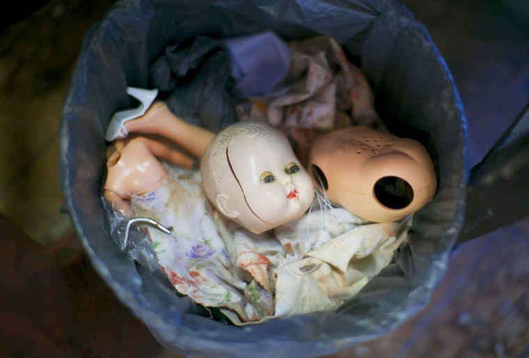 A trash can featuring discarded doll parts including a broken head, torso and limbs is pictured in the workshop of Sydney's Doll Hospital. (Jason Reed/Reuters)