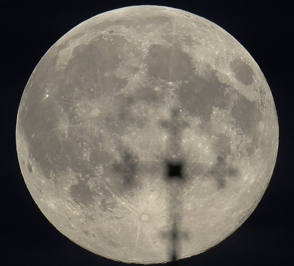 The supermoon is seen behind a cross of an Orthodox church in Minsk, August 10, 2014. The astronomical event occurs when the moon is closest to the Earth in its orbit, making it appear much larger and brighter than usual. (Vasily Fedosenko/Reuters)