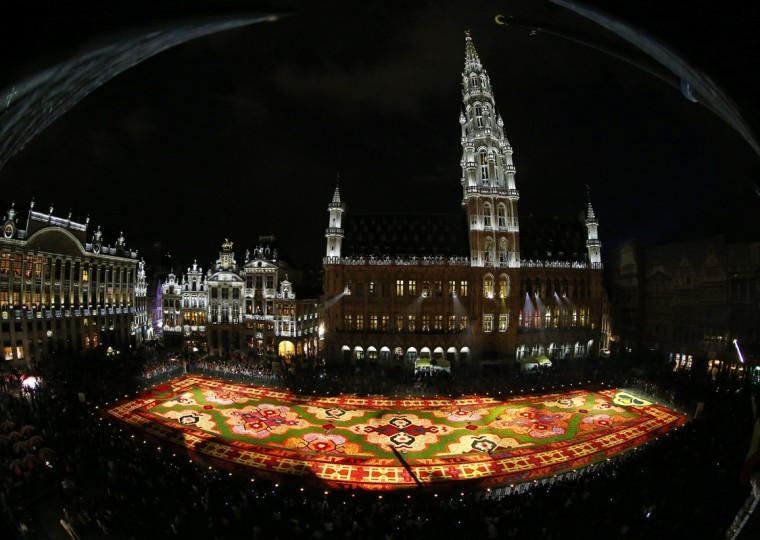 A giant flower carpet is seen at Brussels' Grand Place, August 14, 2014. This year's theme for the flower carpet is Turkey and around 750,000 begonias were needed to create the 1,800 square meter flower carpet design, according to the event organisers. (Yves Herman/Reuters)