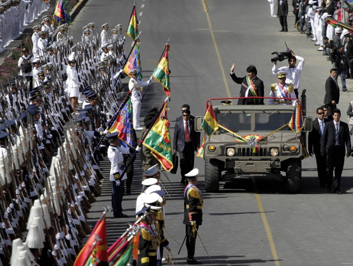 Bolivia's President Evo Morales (R) waves as he reviews the contingent during a military parade held to commemorate the 189th anniversary of the Bolivian Army in La Paz August 7, 2014. (David Mercado/Reuters)