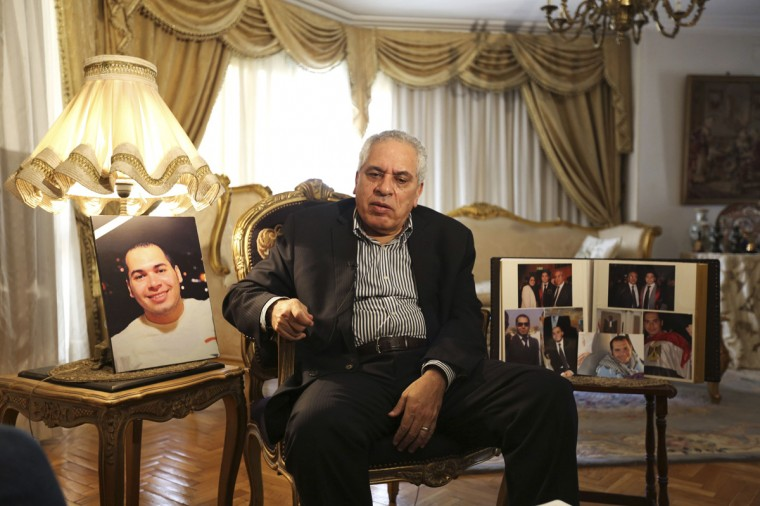 Gamal Siam, a Cairo University professor, talks during an interview with Reuters next to a picture of his deceased his son Sherif in Cairo August 10, 2014. One year since Egyptian security forces stormed two Cairo camps, killing hundreds of protesters demanding the reinstatement of elected Islamist President Mohamed Mursi, Egyptians remain deeply divided over the future of their country. Egyptian police arrested 29-year-old Sherif Siam while clearing a Cairo protest camp one year ago. Four days later, he and 36 others suffocated in a packed police van on the way to jail. Picture taken August 10, 2014. (Mohamed Abd El Ghany/Reuters)