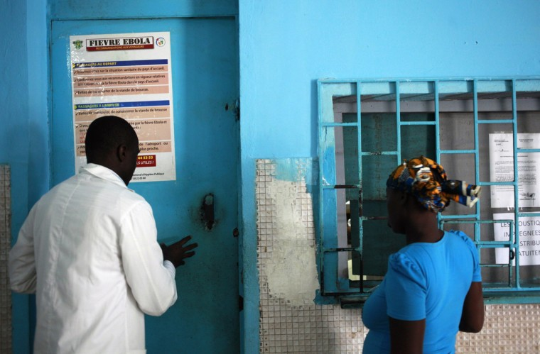 A woman stands at a pharmacy next to a poster displaying a government message against Ebola, at a maternity hospital in Abidjan August 14, 2014. The world's worst outbreak of Ebola has claimed the lives of 1,069 people and there are 1,975 probable and suspected cases, the vast majority in Guinea, Liberia and Sierra Leone, according to new figures from the World Health Organisation (WHO). Ivory Coast has recorded no cases of Ebola. (Luc Gnago/Reuters)