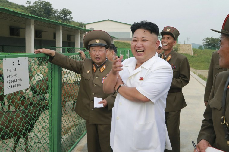 North Korean leader Kim Jong Un laughs during a visit to Breeding Station No. 621 of the Korean People's Army (KPA) in this undated photo released by North Korea's Korean Central News Agency (KCNA) in Pyongyang on August 21, 2014. (KCNA/Reuters)
