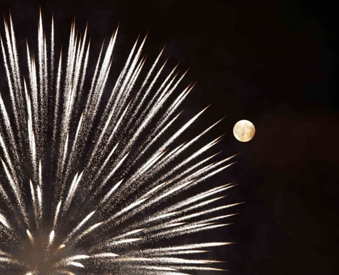 Fireworks explode in front of the supermoon outside the town of Mosta, celebrating the feast of its patron saint, in central Malta, August 10, 2014. The astronomical event occurs when the moon is closest to the Earth in its orbit, making it appear much larger and brighter than usual. (Darrin Zammit Lupi/Reuters)