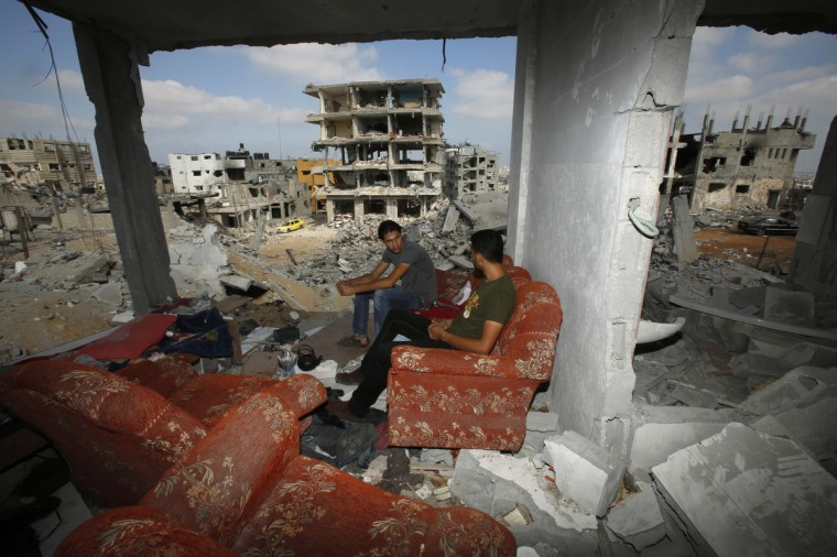 Palestinians sit on a couch as they return to the remains of their house, which witnesses said was destroyed in an Israeli offensive, after a ceasefire was declared, in the east of Gaza City. The open-ended ceasefire in the Gaza war between Israel and the Palestinians held on Wednesday as Prime Minister Benjamin Netanyahu faced strong criticism in his country's newspapers over a campaign in which no clear victor emerged. (Suhaib Salem/Reuters)