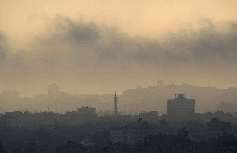 Smoke rises during an Israeli offensive in Gaza August 26, 2014. Israeli air strikes launched before dawn on Tuesday killed two Palestinians and destroyed much of one of Gaza's tallest apartment and office buildings, setting off huge explosions and wounding 20 people, Palestinian health officials said. Israel had no immediate comment on the attacks that took place as Egyptian mediators stepped up efforts to achieve an elusive ceasefire to end seven weeks of fighting. Israel launched an offensive on July 8, with the declared aim of ending rocket fire into its territory. (Ahmed Zakot/Reuters)