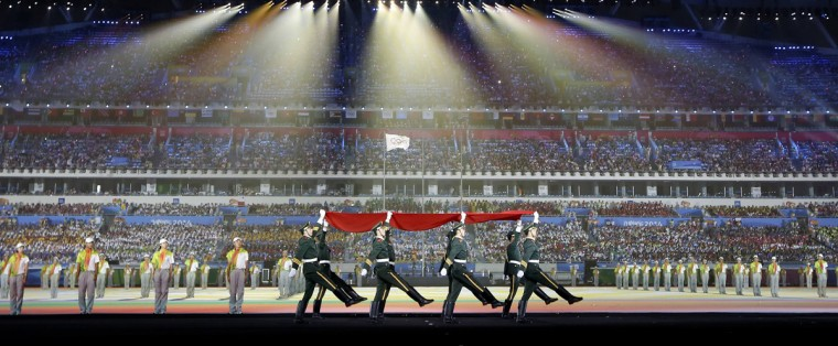 Paramilitary police officers hold the Chinese national flag in a flag-raising ceremony during the closing ceremony of the 2014 Nanjing Youth Olympic Games in Nanjing, Jiangsu province August 28, 2014. (Aly Song/Reuters)