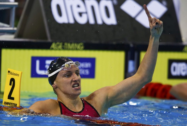 Katinka Hosszu of Hungary gestures after winning the women's 100m backstroke final at the European Swimming Championships in Berlin August 21, 2014. Hosszu placed first jointly with Mie Nielsen of Denmark. (Michael Dalder/Reuters)