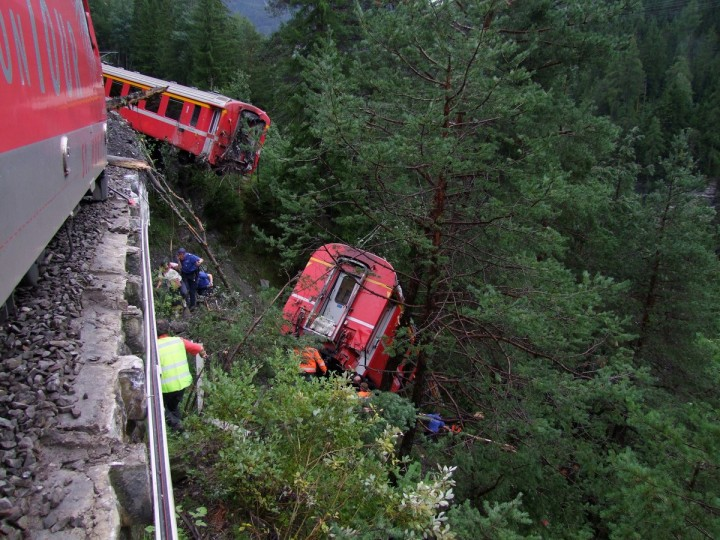 Police and rescue workers help after a passenger train derailed into a ravine near Tiefencastel in a mountainous region of southeastern Switzerland after encountering a mudslide on the tracks . Several passengers were injured after at least three train carriages came off the tracks near Tiefencastel, a village less than 50 km (31 miles) northwest of the ski resort St. Moritz. (Kantonspolizei Graubunden/Reuters)