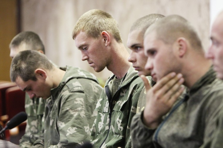 "A group of Russian servicemen, who are detained by Ukrainian authorities, attend a news conference in Kiev. Ukraine said on Tuesday its forces had captured a group of Russian paratroopers who had crossed into Ukrainian territory on a ""special mission"" - but Moscow said they had ended up there by mistake. (Valentyn Ogirenko/Reuters)"