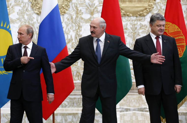 (L-R) Russia's President Vladimir Putin, Belarus' President Alexander Lukashenko and Ukraine's President Petro Poroshenko react while posing for a family photo during their meeting in Minsk, August 26, 2014. Putin said on Tuesday the crisis in Ukraine could not be solved by a further military escalation or without dialogue with representatives of the country's Russian-speaking eastern regions. (Grigory Dukor/Reuters)