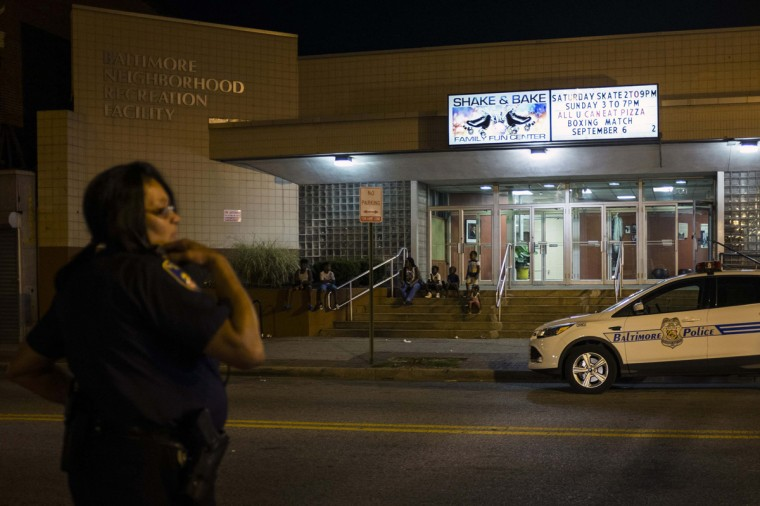 Police patrol outside a community recreation center after a curfew law took effect in Baltimore August 8, 2014. Mayor Stephanie Rawlings-Blake said the measure, which took effect on Friday, was aimed at getting children off the streets before they were put in danger. (James Lawler Duggan/Reuters)