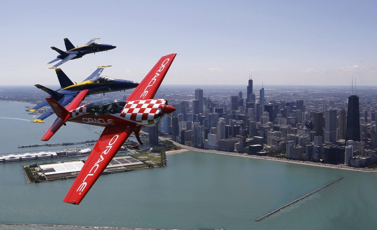 Sean Tucker pilots his plane along with two members of the U.S. Navy Blue Angels in preparation for the 56th Annual Chicago Air and Water Show in Chicago, Illinois, August 14, 2014. (Jim Young/Reuters)