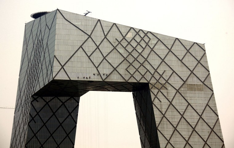 Cleaners abseil down the side of the China Central Television (CCTV) building in central Beijing on June 1, 2012. (REUTERS/David Gray)