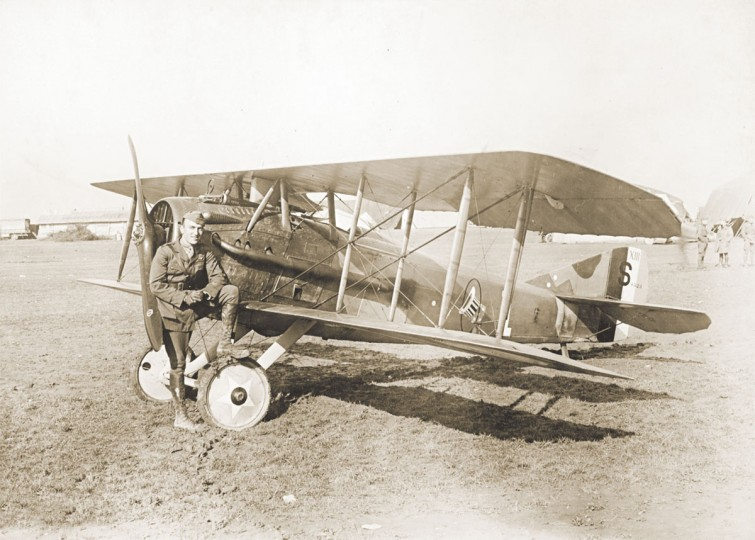 "1st Lt. Eddie Rickenbacker, America's most successful World War One fighter ace, is seen next to a biplane in an undated photo. World War One pioneered many ""firsts"" in technological, scientific and societal innovations. Aircraft were deployed in war en masse for the first time, for both air to air combat and for reconnaissance. (REUTERS/Handout via U.S. National Archives)"
