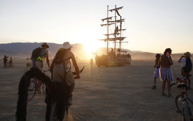 "A pirate ship cruises the Playa during the Burning Man 2014 ""Caravansary"" arts and music festival in the Black Rock Desert of Nevada August 26, 2014. People from all over the world have gathered at the sold out festival to spend a week in the remote desert cut off from much of the outside world to experience art, music and the unique community that develops. (Jim Urquhart/Reuters)"