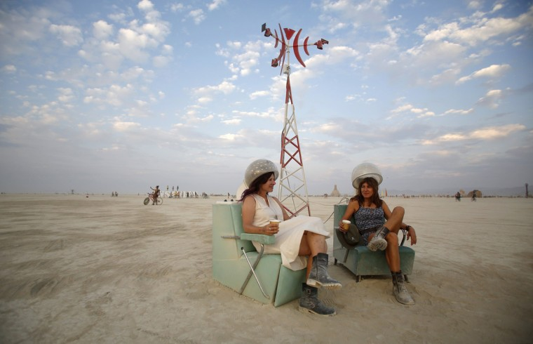 "Rosanne Ziering (L) and Alison Cooper relax on the Playa during the Burning Man 2014 ""Caravansary"" arts and music festival in the Black Rock Desert of Nevada, August 28, 2014. (Jim Urquhart/Reuters)"