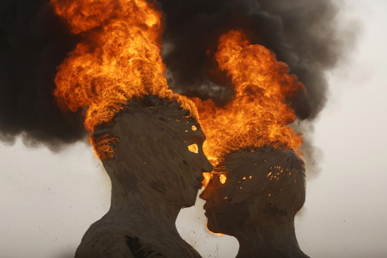 "The art installation Embrace burns during the Burning Man 2014 ""Caravansary"" arts and music festival in the Black Rock Desert of Nevada, August 29, 2014. (Jim Urquhart/Reuters)"