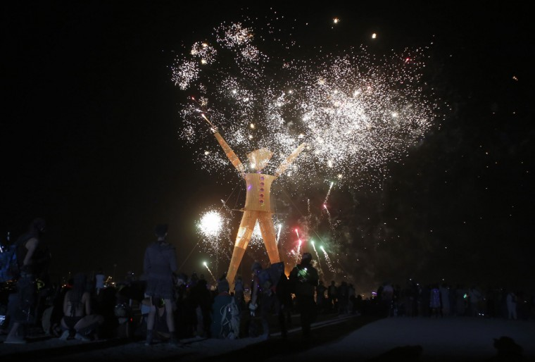 "Fireworks are seen before the Man burns during the Burning Man 2014 ""Caravansary"" arts and music festival in the Black Rock Desert of Nevada, August 30, 2014. (Jim Urquhart/Reuters)"