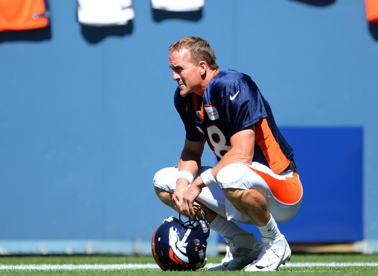 Denver Broncos quarterback Peyton Manning (18) watches from the sideline prior to the start of a scrimmage at Sports Authority Field in Denver. (Ron Chenoy/USA Today Sports)