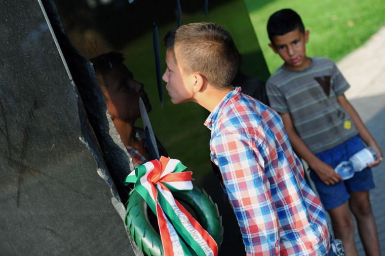 A boy looks through the black marble monument for Roma holocaust victim of the Auschwitz-Birkenau death camp, in Nehru park, in Budapest during the International Day of Remembrance for the Holocaust of the Roma. The march was held on the 70th anniversary of one of the worst mass killings of Roma, when nearly 3,000, many of them children, were taken to the gas chambers at Auschwitz on the night of August 2, 1944. (Attila Kisbenedek/AFP-Getty Images)