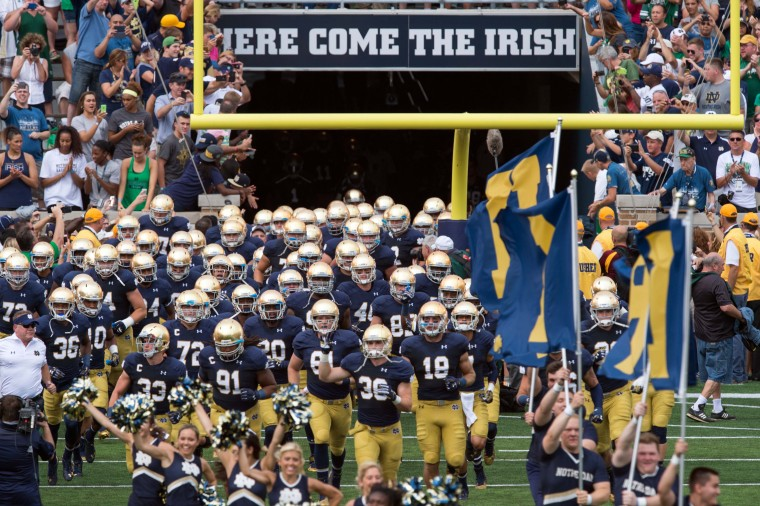 The Notre Dame Fighting Irish take the field before their game against the Rice Owls at Notre Dame Stadium in South Bend, Indiana. (Matt Cashore/USA Today Sports)