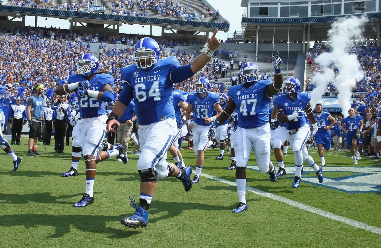 The Kentucky Wildcats take the field before the game against the Tennessee- Martin Skyhawks at Commonwealth Stadium in Lexington, Kentucky. (Andy Lyons/Getty Images)